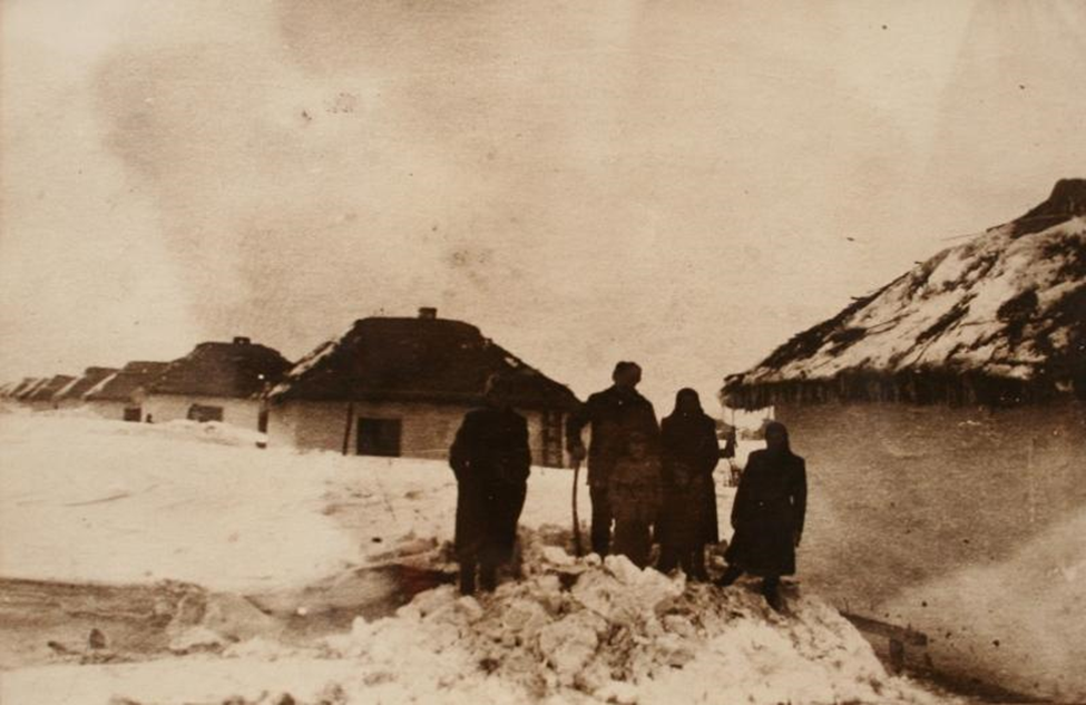 """""""The Stoianov family in the snows of Bărăgan (Schei, 1954)"""" Source: Memorial to the Victims of Communism and Resistance, Civic Academy Foundation, Sighetu Marmatiei"""