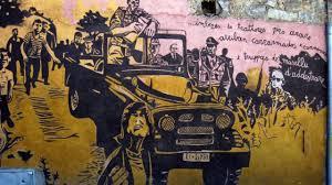 Antimilitarist murals. Cosi la Sardegna continua nella sua lotta antimilitarista – Lettera43