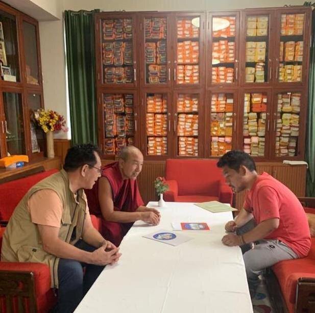Serkong Rinpoche, Geshe Samdrup la and Thupten Sherap looking at Serkong School logo versions - photo courtesy of Tsenshap Serkong Labrang