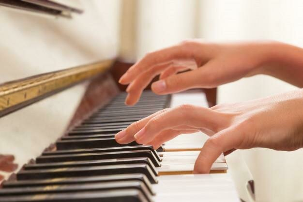 female-hands-playing-piano_41451-422
